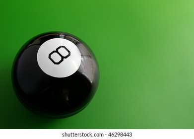 closeup of a billiard 8 ball on a pool table