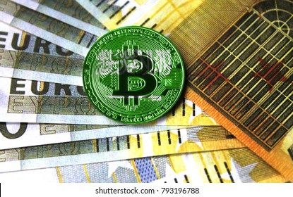 A close-up of bitcoin against the background of euro money, the flag Saudi Arabia is depicted on the coin of bitcoin.