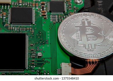 Close-up of bitcoin, computer circuit board with bitcoin processor and microchips. Electronic currency, internet finance rypto currency. Bitcoin mining.