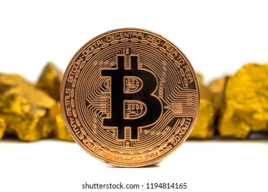 Closeup of bitcoin digital currency and gold nugget or gold ore on white background, precious stone or lump of golden stone, Cryptocurrency money financial and business concept idea.