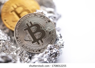 Close-up of bitcoin on the foil surface