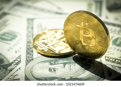 Close-up Bitcoins on dollar banknote; Crytocurrency concept