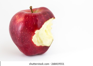 Close-up of an bitten apple on white background and copy space.