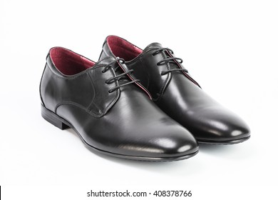 Close-up of  the black elegant man's shoes isolated on white background.