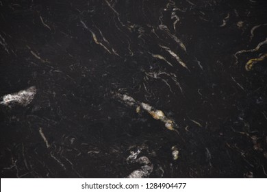 Closeup black granite stone with natural pattern texture background.