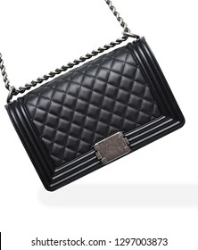 Close-up of black handbag on white background. Steel chain and leather with diamonds. Luxurious accessory