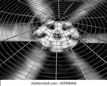 Closeup of black HVAC (Heating, Ventilation and Air Conditioning) spinning blades. Industrial ventilation fan background.