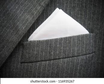 Close-up of black men's suit chest pocket. Vertical version please check  Image ID: 142145656.