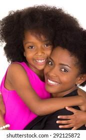 Closeup black mother daughter posing happily and hugging