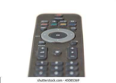 Close-up of a black Remote Control, focus on OK button