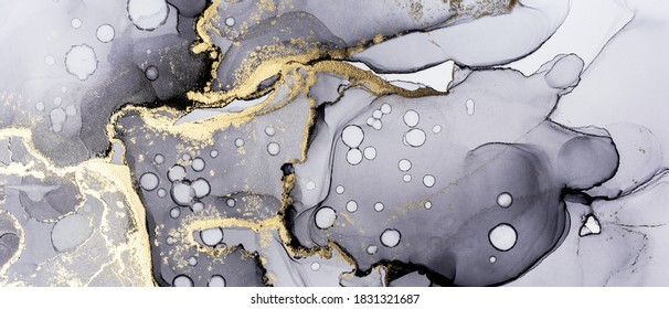 Closeup of black and shiny golden alcohol ink abstract texture, trendy wallpaper. Art for design project as background for invitation or greeting cards, flyer, poster, presentation, banner