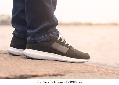 closeup black sneakers with Cushion againt sun light
