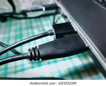 Close-up Black USB Cable Connected to a Laptop