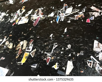 Close-up of a black wall with torn-off announcements