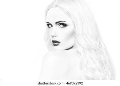 Close-up black and white portrait of beautiful stylish blonde girl