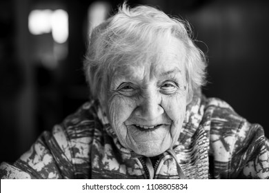 Close-up of black and white portrait of an elderly woman.