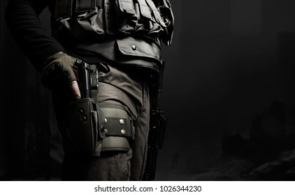 Closeup black and white swat soldier with gun. Closeup black and white photo of equipped swat soldier holding a gun profile view.