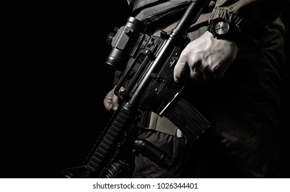 Closeup black and white swat soldier. Closeup black and white photo of equipped swat soldier holding a rifle profile view.