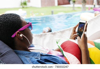 Closeup of black woman using mobile phone listening music
