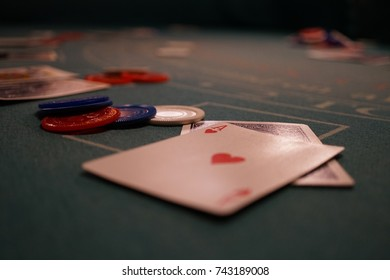 Close-up of a blackjack table with a hand showing an Ace of Hearts