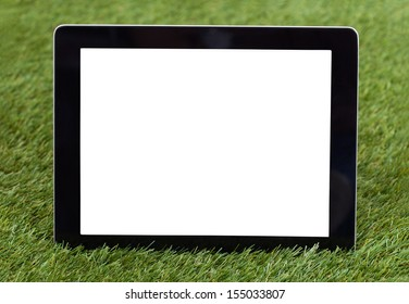Close-up Of Blank Digital Tablet On Green Grass