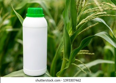 Closeup blank unlabelled bottle as mockup copy space for herbicide, fungicide or insecticide.- Image
