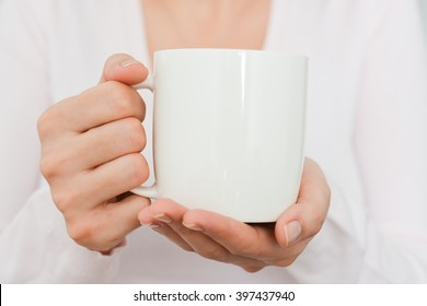 Close-up of Blank white cup in woman hand