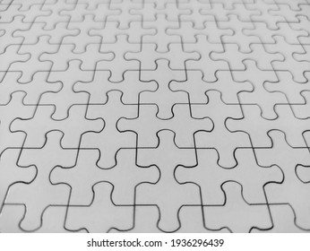 Close-up of blank white jigsaw puzzle texture background