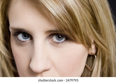 Closeup of blond woman's face & eyes
