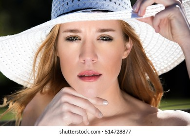 Closeup of Blonde Female in White Hat