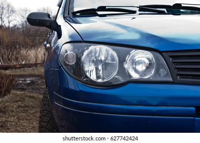 Close-up of a blue car headlight