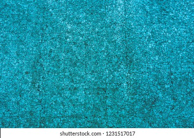 Close-up of a Blue colored mosaic Stone Wall usable as decorative Background, Surface or Texture.