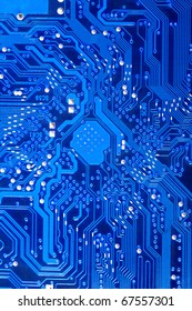 Closeup of a blue computer circuit board. Technological background