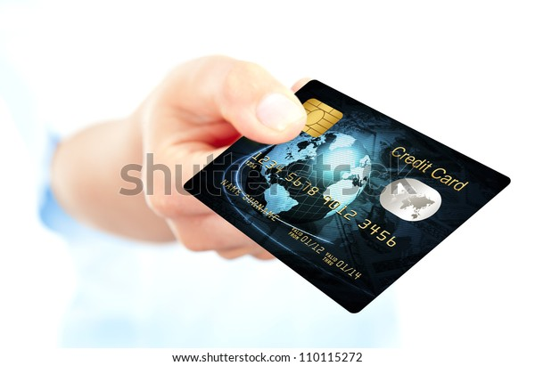 closeup of blue credit card holded by hand. focus on card