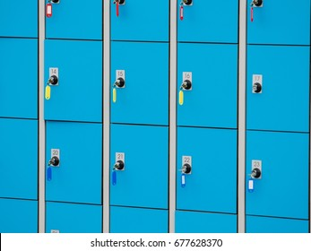 closeup blue deposite boxes with keys. left luggage checkroom background