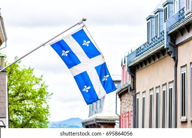 Closeup of blue flag in upper old town street Quebec City, Canada looking down steep hill