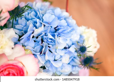 Close-up of blue hydrangea in bouquet.