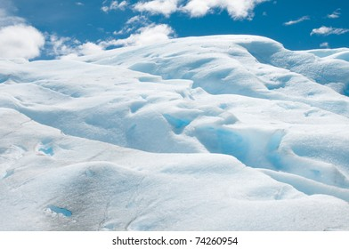 Close-up of the blue ice formations and blue sky over the Perito Merino glacier, Argentina