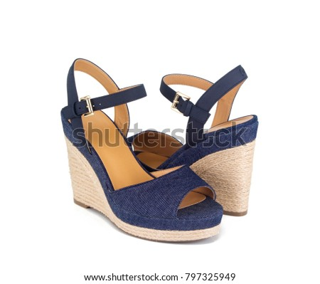 6e446b81f38 Closeup of blue jean material espadrille wedge sandals. Isolated on white  and shot in studio