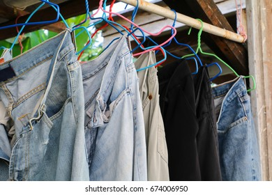 closeup blue jeans in a row on hanger