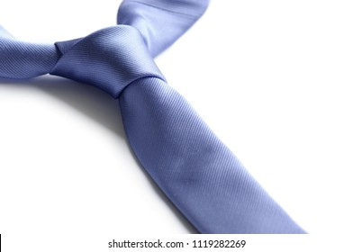 Close-up blue neck tie isolated on white background