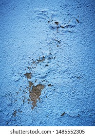 closeup of blue painted ancient wall showing signs of weathering and pealing damage