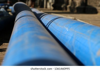 Closeup blue PVC pipe on the floor. (Polyvinyl chloride)
