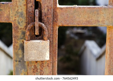 Closeup a blue rusty old metal door locked with a metal padlock. Grunge style and good texture. Security concept.