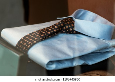 closeup of blue shirt and tie in a fashion store showroom for men
