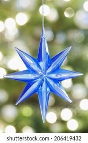 Closeup of blue star shape Christmas ornament