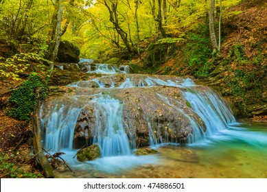 closeup blue waterfall  autumn scene