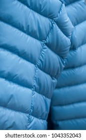 closeup of blue winter coat in fashion store showroom