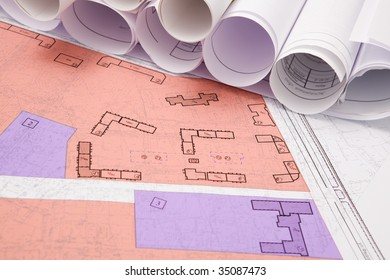 Close-up of blueprints with sketches of projects on workplace