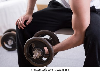 Close-up of bodybuilder working out with dumbbell
